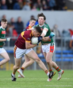 Conor Cleary of Miltown in action against Keelan Sexton of Kilmurry Ibrickane during their senior football county final at Cusack Park. Photograph by John Kelly.