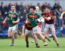 Keelan Sexton of Kilmurry Ibrickane in action against Brian Curtin and Gordon Kelly (C) of Miltown during their senior football county final at Cusack Park. Photograph by John Kelly.