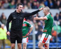 Enda Couglan of Kilmurry Ibrickane protests to referee Chris Maguire during their senior football county final at Cusack Park. Photograph by John Kelly.