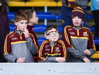 Young Miltown Malbay fans come to terms with the draw during their senior football county final at Cusack Park. Photograph by John Kelly.