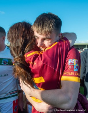Oisin Looney of Miltown is congratulated by his aunt Geraldine following their senior football county final replay win over KIB at Cusack Park. Photograph by John Kelly.