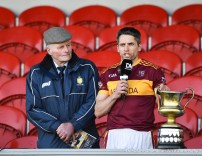 Gordon Kelly (C) of Miltown makes his acceptance speech after collecting the silverware following their senior football county final replay win over KIB at Cusack Park. Photograph by John Kelly.