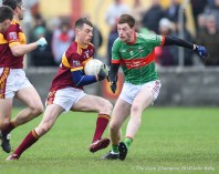 Kieran Malone of Miltown in action against Michael Curry (C) of Rathgormack of during their Munster Club quarter final at Miltown. Photograph by John Kelly