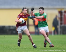 Gordon Kelly (C) of Miltown in action against Billy Power of Rathgormack of during their Munster Club quarter final at Miltown. Photograph by John Kelly