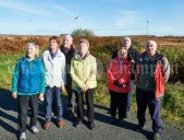 Walksrs stop to watch the Monmore windmills spinning during the Shades Of Autumn 10k walk in aid of the RNLI on bank Holiday Monday at Shragh. Photograph by John Kelly.
