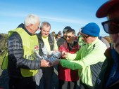 Joe Queally and Michael Mc Mahon offer black pudding and brown bread to hungry walkers during the Shades Of Autumn 10k walk in aid of the RNLI on bank Holiday Monday at Shragh. Photograph by John Kelly.