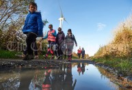 Walkers are reflected in a bog road puddle during the Shades Of Autumn 10k walk in aid of the RNLI on bank Holiday Monday at Shragh. Photograph by John Kelly.