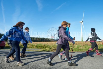 Walkers pass by windmills on the Shades Of Autumn 10k walk in aid of the RNLI on bank Holiday Monday at Shragh. Photograph by John Kelly.