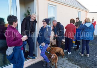 Peadar Mc Mahon chatting on nhis doorstep to sisters Caroline Bradley and Pauline Dunleavy when they stopped to avail of refreshments at his home while taking part in the Shades Of Autumn 10k walk in aid of the RNLI on bank Holiday Monday at Shragh. Photograph by John Kelly.