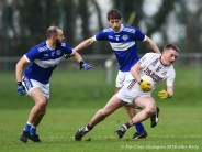 Dale Masterson of St Breckan's in action against Sean Sheehan and Tom Spillane of Templenoe during their Munster Club Intermediate final at Mallow. Photograph by John Kelly