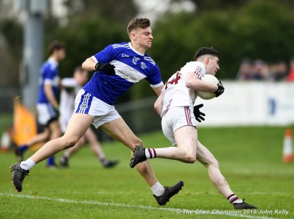 Josh Crowley Holland of Templenoe in action against Joseph Mc Gann of St Breckan's during their Munster Club Intermediate final at Mallow. Photograph by John Kelly