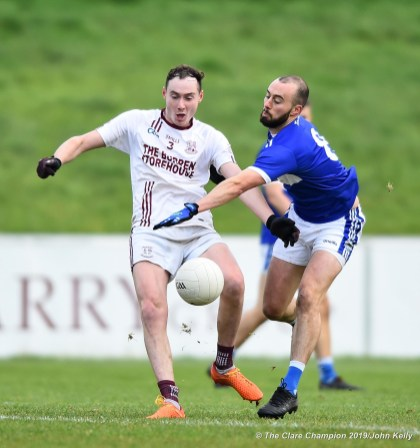 Evan Barrett of St Breckan's in action against Sean Sheehan of Templenoe during their Munster Club Intermediate final at Mallow. Photograph by John Kelly