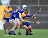 David Reidy of Clare in action against Willie Dunphy and Ryan Mullaney of Laois during their National League game at Cusack Park. Photograph by John Kelly