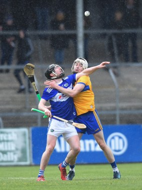 Ryan Taylor of Clare in action against John Lennon of Laois during their National League game at Cusack Park. Photograph by John Kelly