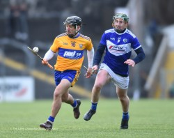 David Reidy of Clare in action against Willie Dunphy of Laois during their National League game at Cusack Park. Photograph by John Kelly
