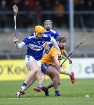 Ian Galvin of Clare in action against Padraig Delaney of Laois during their National League game at Cusack Park. Photograph by John Kelly