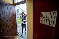 Doon's Marie Lynch braving the weather as she arrives at Ballinruan community Centre to cast her vote in the General Election 2020. Photograph by John Kelly.
