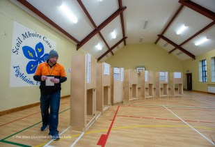 A man casts his vote during voting in the General Election 2020 at Corofin Polling Station. Photograph by John Kelly.