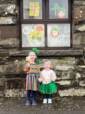 Anna and Ella Connole with their Paddys Day themed window in the background