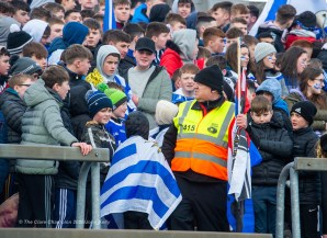 A steward confiscates flags from St Flannan's fans before their Harty Cup final against CBC Cork at Mallow. Photograph by John Kelly