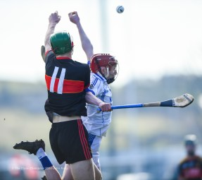 Niall Hartnett of CBC Cork in action against Eimhin Wall of St Flannan's during their Harty Cup final at Mallow. Photograph by John Kelly