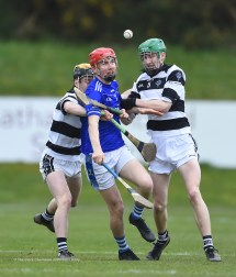 Stephen Casey of St Flannan's in action against Denis Walsh and Peter Mc Donald of St. Kieran's College Kilkenny during their Croke Cup quarter final at Mallow. Photograph by John Kelly