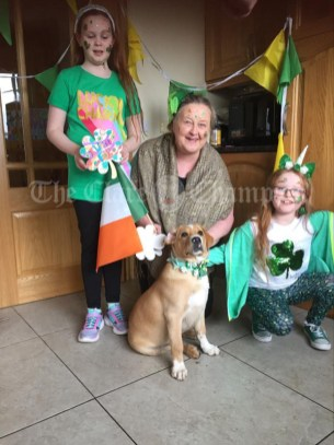 Monica Roisin and Robyn Carmody Kilmihil with Charlie Two Socks his very first St Patrick's Day