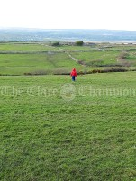 Maria O'Brien's little boy high up on the green hills just outside Lahinch.