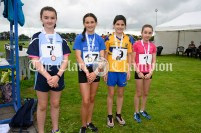 Medal winners in the Girls 100m event were (l-r) Simone Considine (Cooraclare-Cree), Rebecca Reid (Inch-Kilmaley-Connolly), Kate Monahan (Sixmilebridge-Kilmurry) and Ava O'Boyle (Ennis-St-Johns). Photography by Eugene McCafferty