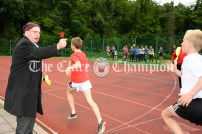 Clare Community Games stalwart Tommy McCarthy rings his bell to signal the last lap for track runners. Photography by Eugene McCafferty