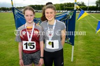 2nd place Ava Rochford (Ennis-St-Johns) and winner Lisa Nicholas from Tulla with their U16 Girls High Jump medals. Photography by Eugene McCafferty