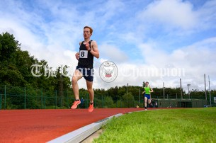Gerard Dunne from Doonbeg strides to victory in the U16 Boys 1500m event. Photography by Eugene McCafferty