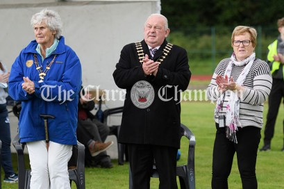 Cecilia O'Sullivan ( President of Clare Community Games), Cllr PJ Ryan (Cathaoirleach of Clare County Council) and Mary Phelan (PRO) stand for one minute's applause in memory of the late Rose Meakins who died on 6th April 2020. A stalwart of Clare Community Games, Rose had been involved for over forty years for which she had achieved Honorary Patron status. Her husband Graham and son Stuart were present at the county athletics finals. Photography by Eugene McCafferty