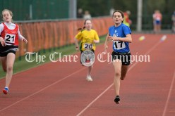 Rebecca Reid from Inch-Kilmaley-Connolly takes victory in her stride during the Girls U12 100m event. Photography by Eugene McCafferty