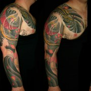 Chestplate and dragon full sleeve cover up tattoo