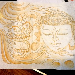 Freehand stencil drawing of Buddah and Tibetan skull