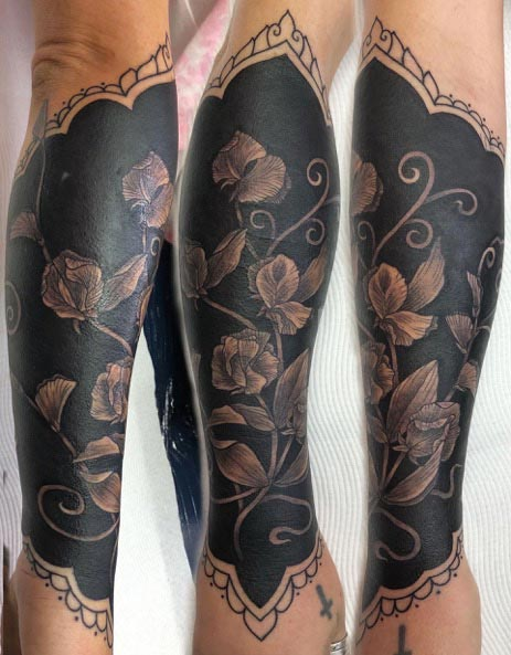 Sweet Pea tattoo cover up by Clare Keton
