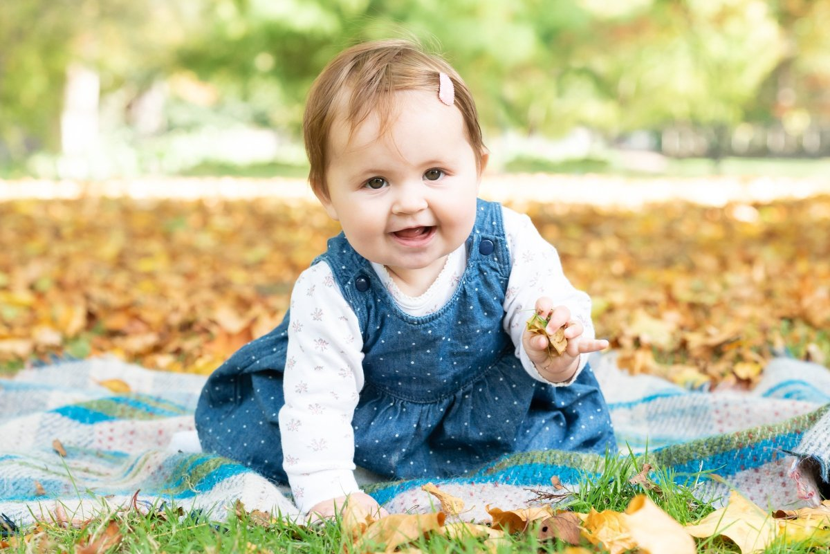 Baby photo in the autumn leaves