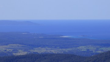 The southern tip of Booderee National Park with Lake Conjola, Green Island and Bendalong visible in the foreground.