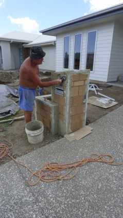 Applying the first coat of render.