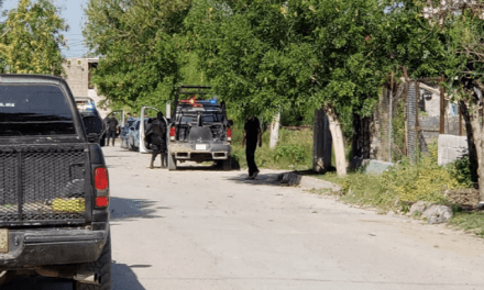 Gunmen in Mexican Border City Leave Threat by Murder Victim