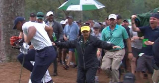 WATCH: Tiger Woods Tripped up by Long Leg of the Law