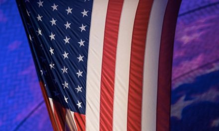 Atheist group complains 'God bless America' is said at elementary school after daily pledge. District quickly falls in line.