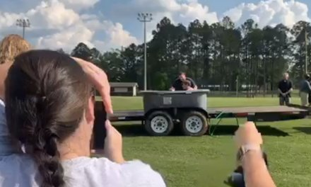 Atheist group objects after video reportedly shows 'several football players' baptized on public school property
