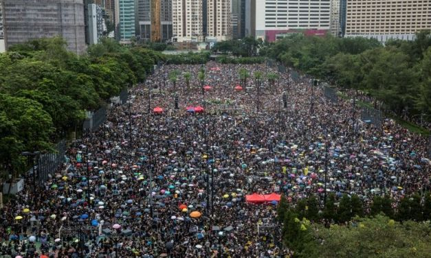 Hong Kong protesters flood city streets for largest rally in weeks