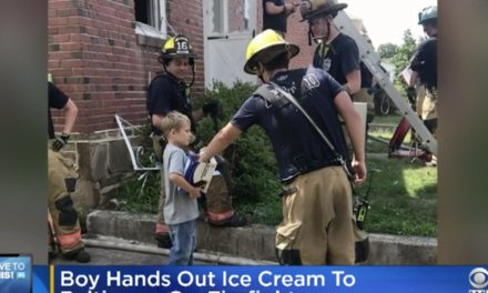 Firefighters battle intense house fire. Area boy is on hand to reward them with ice cream sandwiches.