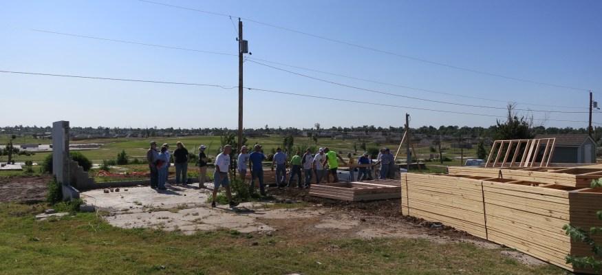 Clark talks to Habitat homeowner in Joplin