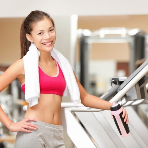 gym member on treadmill