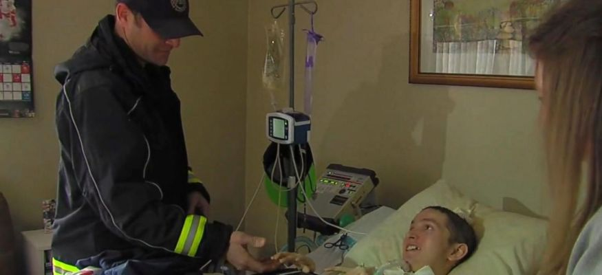 Firefighter pays family's $1,000 electric bill to keep teen on ventilator