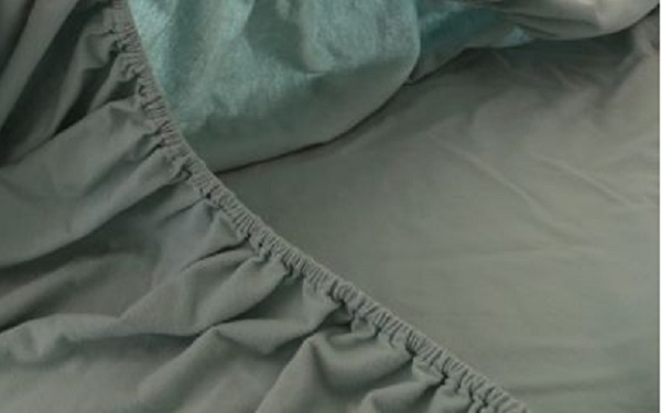Quick and easy way to fold a fitted sheet